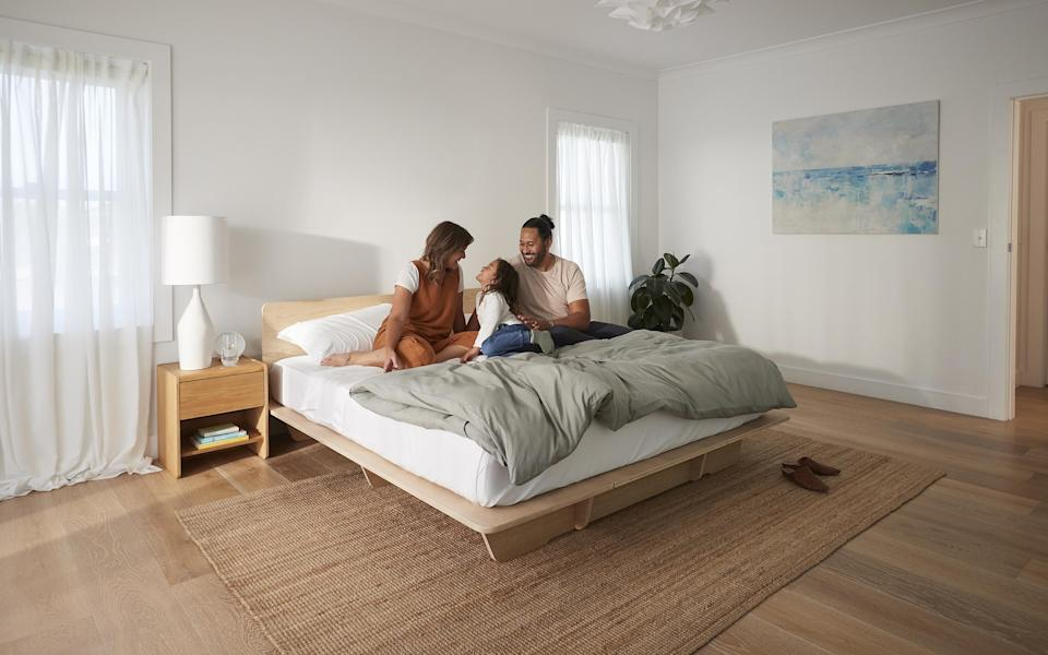 A couple and their daughter on a bed and mattress by Koala