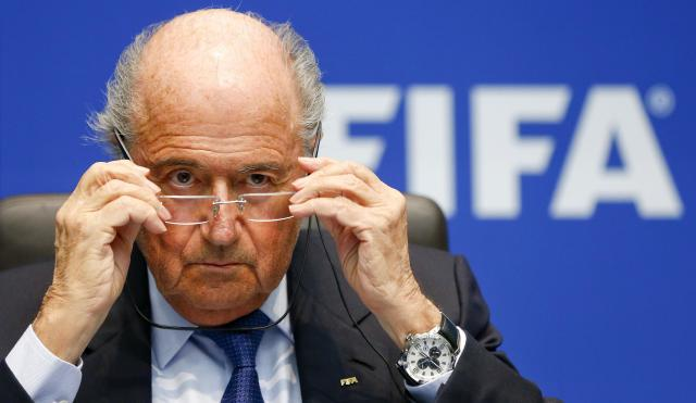 FIFA President Sepp Blatter adjusts his glasses as he addresses a news conference after a meeting of the FIFA executive committee in Zurich March 21, 2014. REUTERS/Arnd Wiegmann (SWITZERLAND - Tags: SPORT SOCCER HEADSHOT)
