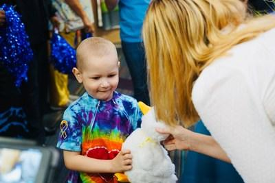 Alex, a child with cancer, receives a My Special Aflac Duck at Roswell Park Comprehensive Cancer Center on Aug. 23, 2019.