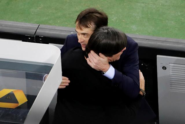 Soccer Football - International Friendly - Germany vs Spain - ESPRIT arena, Dusseldorf, Germany - March 23, 2018 Spain coach Julen Lopetegui hugs Germany coach Joachim Loew after the match REUTERS/Wolfgang Rattay