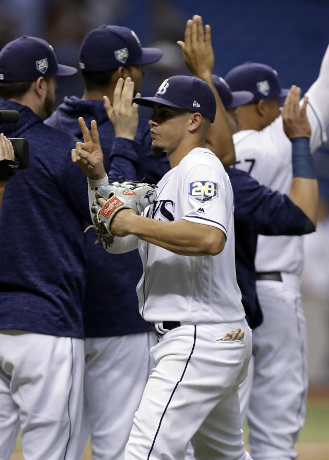 Tampa Bay Rays' Willy Adames celebrates with teammates after the Rays defeated the Kansas City Royals 1-0 during a baseball game Monday, Aug. 20, 2018, in St. Petersburg, Fla. (AP Photo/Chris O'Meara)