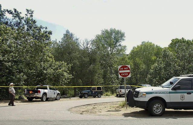 <p>The Water Wheel Campground parking lot is blocked off by authorities Sunday, July 16, 2017, in the Tonto National Forest, Ariz., after a deadly flash-flooding hit Saturday afternoon at Cold Springs canyon. (Alexis Bechman/Payson Roundup via AP) </p>