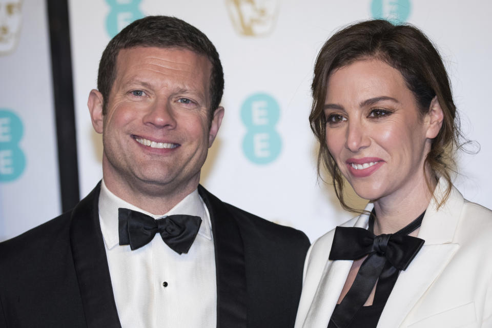 Dermot O'Leary and Dee Koppang pose for photographers upon arrival at the BAFTA Film Awards in London, Sunday, Feb. 10, 2019. (Photo by Vianney Le Caer/Invision/AP)