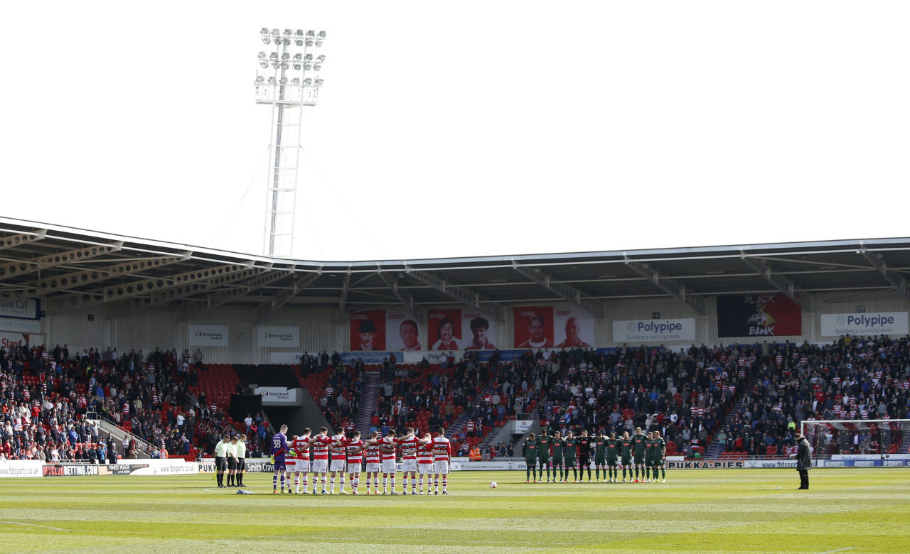 "Britain Football Soccer - Doncaster Rovers v Plymouth Argyle - Sky Bet League Two - Keepmoat Stadium - 26/3/17 Players observe a minutes silence in respect for the victims of the London attack before the game  Action Images via Reuters / Ed Sykes Livepic EDITORIAL USE ONLY. No use with unauthorized audio, video, data, fixture lists, club/league logos or ""live"" services. Online in-match use limited to 45 images, no video emulation. No use in betting, games or single club/league/player publications.  Please contact your account representative for further details."