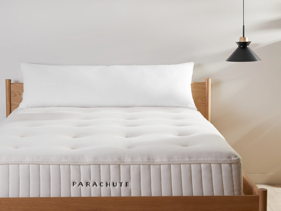 "<h3><strong>Parachute Down Alternative Body Pillow</strong></h3><br>Parachute's oversized body pillow is filled with hypoallergenic microfiber that's encased in a cambric cotton shell. Pair it with one of their <a href=""https://www.parachutehome.com/products/body-pillow-cover-vintage-linen"" rel=""nofollow noopener"" target=""_blank"" data-ylk=""slk:Vintage Linen Body Pillow Covers"" class=""link rapid-noclick-resp"">Vintage Linen Body Pillow Covers</a> to take your bedding game to the next level.<br><br><strong>The Hype:</strong> 4.7 out of 5 stars and 51 reviews on <a href=""https://www.parachutehome.com/products/body-pillow-insert-down-alternative"" rel=""nofollow noopener"" target=""_blank"" data-ylk=""slk:Parachute"" class=""link rapid-noclick-resp"">Parachute</a><br><br><strong>Serious Sleepers Say:</strong> ""100% satisfied and much more. We absolutely LOVE our NEW addition to our bed. The down alternative body pillow is so incredibly soft and very FULL. My favorite thing about it is the size, it's HUGE!!! LOL. Thank you for the amazing quality and helping make our house a HOME."" - <em>Rhonda M., Wayfair reviewer </em><br><br><br><strong>Parachute</strong> Down Alternative Body Pillow Insert, $, available at <a href=""https://go.skimresources.com/?id=30283X879131&url=https%3A%2F%2Fwww.parachutehome.com%2Fproducts%2Fbody-pillow-insert-down-alternative"" rel=""nofollow noopener"" target=""_blank"" data-ylk=""slk:Parachute"" class=""link rapid-noclick-resp"">Parachute</a>"