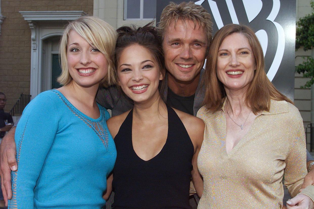 """Actor John Scheneider poses with co-stars (L-R) Allison Mack, Kristin Kreuk and Annette O'Toole from the series """"Smallville."""" at the network's summer All-Star party at the Warner Bros. Studios in Burbank, California, July 15, 2001. The series depicts the classic Superman character as a teenaged Clark Kent. RMP/HK"""