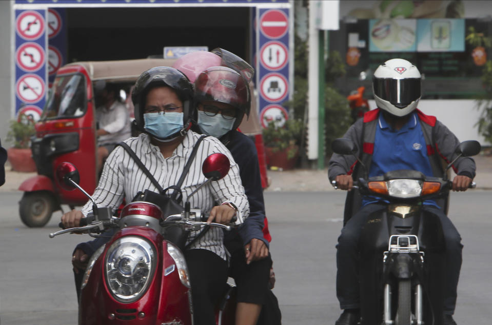 Commuters wear face masks to protect against the spread of coronavirus in Phnom Penh, Cambodia. (AP Photo)
