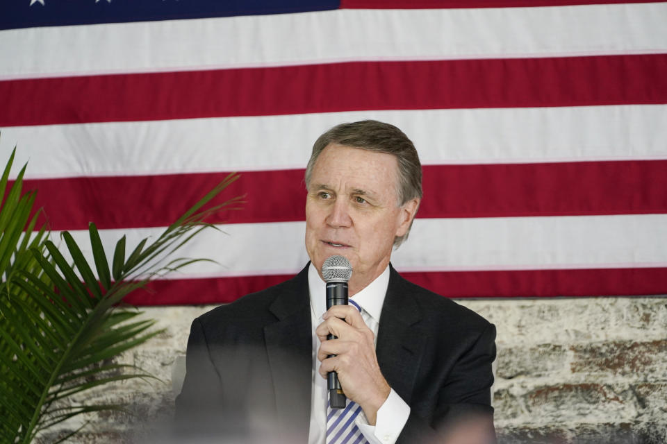 Sen. David Perdue speaks into a microphone