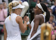 Germany's Angelique Kerber, left, greets Coco Gauff of the U.S. after winning the women's singles fourth round match on day seven of the Wimbledon Tennis Championships in London, Monday, July 5, 2021. (AP Photo/Kirsty Wigglesworth)