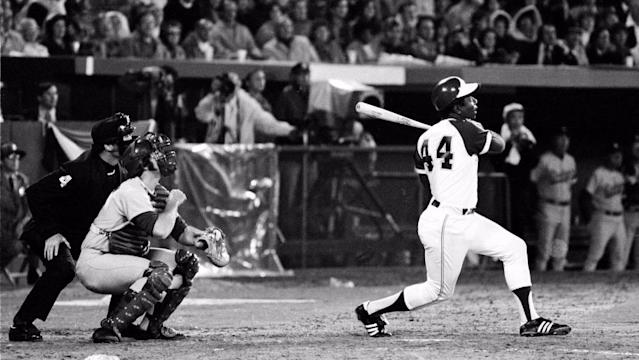 """Hank Aaron watches career home run No. 715 sail over the left-field fence in 1974. <span class=""""copyright"""">(Associated Press)</span>"""