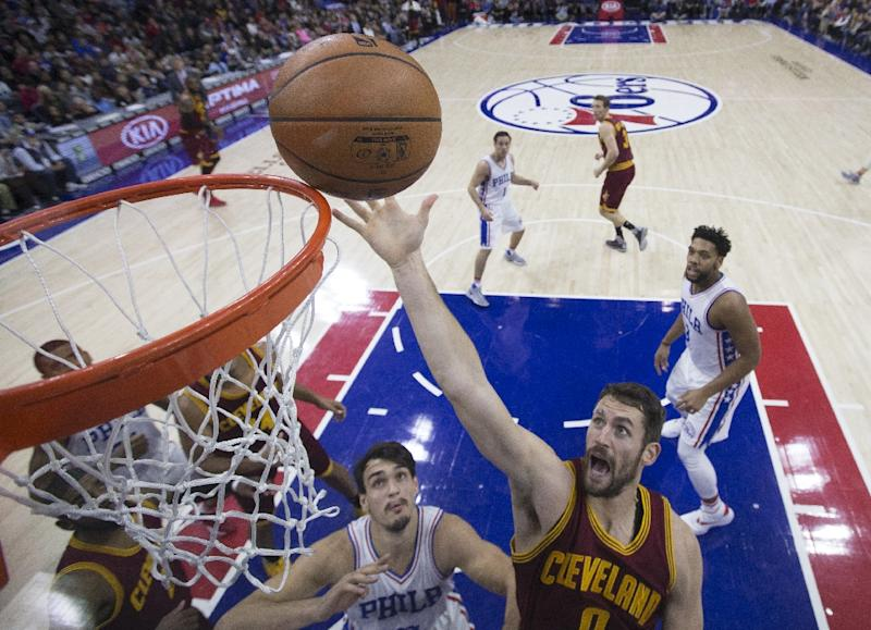 Cleveland Cavaliers center, Kevin Love (R) contributed 25 points and 11 rebounds to the team's 112-108 win over the Philadelphia 76ers (AFP Photo/Mitchell Leff)