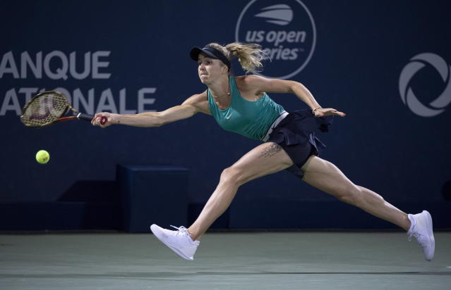 Elina Svitolina, of Ukraine, reaches for a shot from Elise Mertens, of Belgium, during the Rogers Cup womens tennis tournament in Montreal, Friday, Aug. 10, 2018. (Paul Chiasson/The Canadian Press via AP