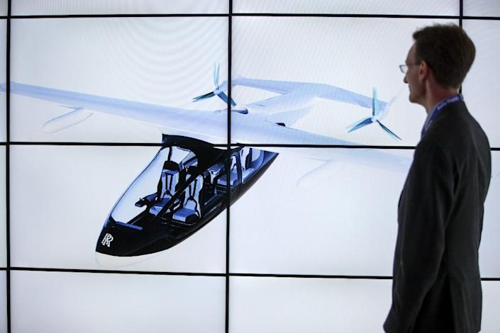 One expert cautioned that Rolls-Royce's flying taxi concept was in reality a development platform to test the new electrical propulsion technology (AFP Photo/Tolga AKMEN)