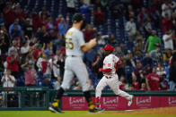 Philadelphia Phillies' Didi Gregorius, right, rounds the bases after hitting a three-run home run against Pittsburgh Pirates pitcher Chasen Shreve during the seventh inning of a baseball game, Friday, Sept. 24, 2021, in Philadelphia. (AP Photo/Matt Slocum)