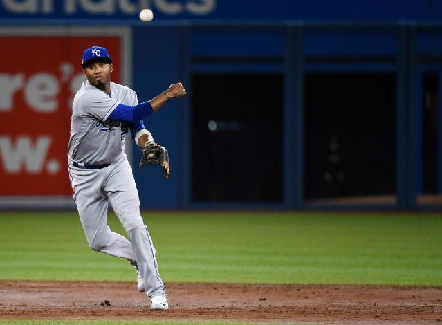 Kansas City Royals shortstop Alcides Escobar (2) throws to first base against the Toronto Blue Jays during the second inning of a baseball game in Toronto on Wednesday, April 18, 2018. (Nathan Denette/The Canadian Press via AP)