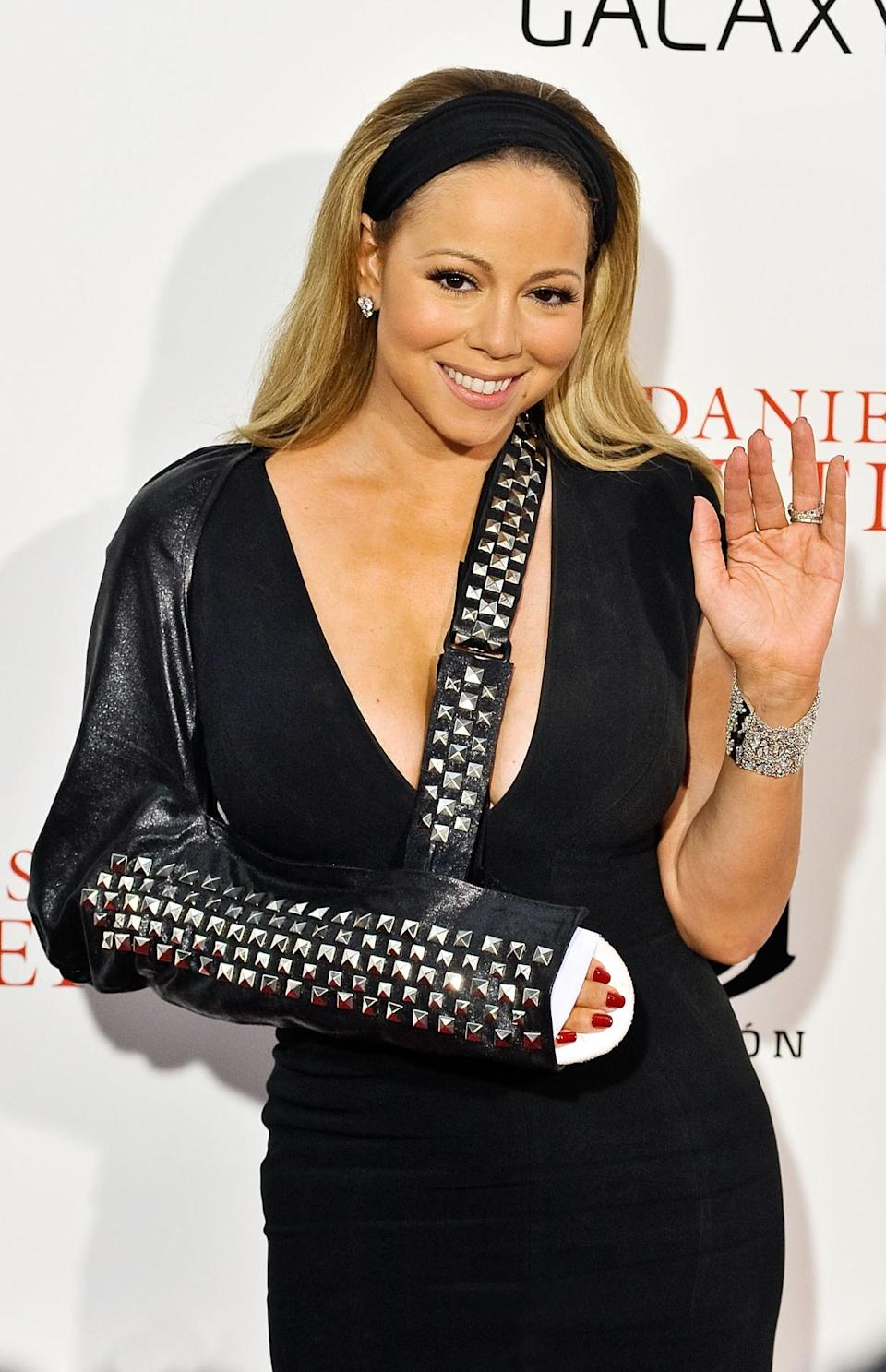 <p>Mariah Carey will go down in history as the celebrity with the most swagged-out broken arm. The butterfly queen went all punk rock on us when she tricked out her leathery arm sling. <i>(Photo: Getty)</i></p>