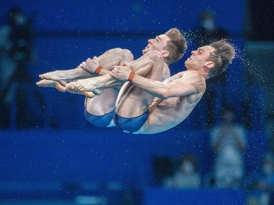 Great Britain's Tom Daley and Matty Lee flip during synchronized diving.