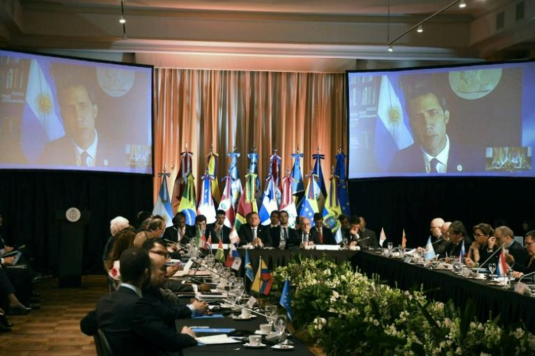 Venezuela's opposition leader Juan Guaido spoke to the Lima Group meeting in Buenos Aires by video link (AFP Photo/DIEGO DEL CARRIL)