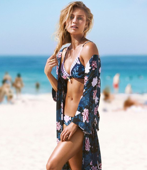 <p>She stuns in a floral Seafolly bikini and and matching kaftan while on a shoot in Bondi. Source: Instagram/elyse.knowles </p>