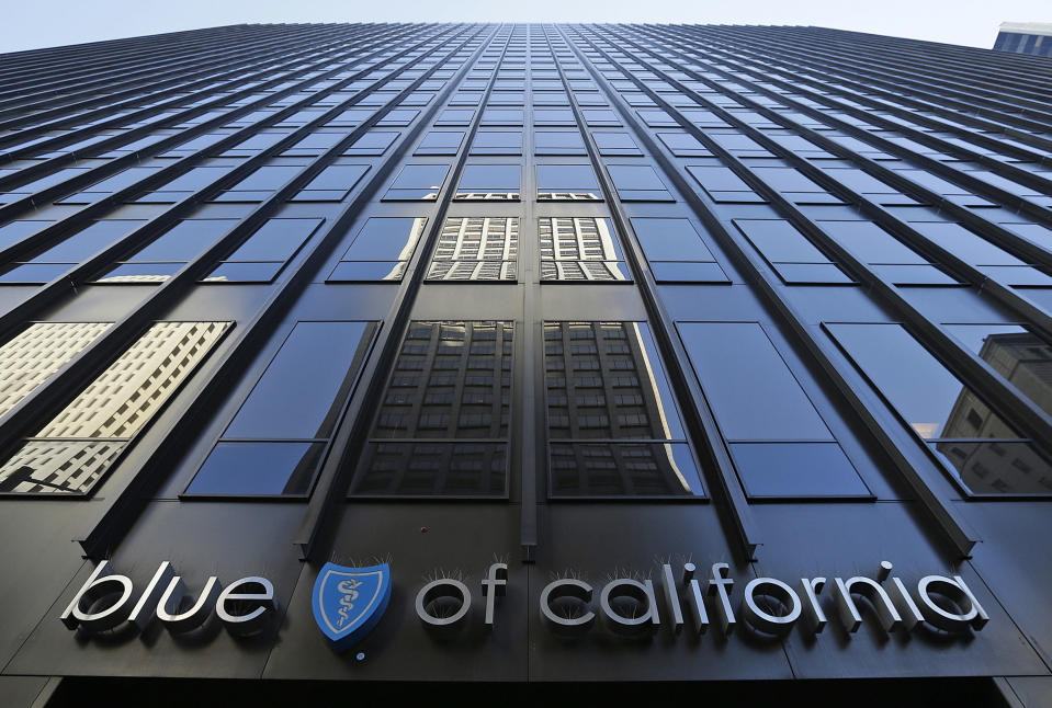 FILE - In this April 8, 2015, file photo, is the headquarters building of Blue Shield of California in San Francisco. California's two largest counties, Los Angeles and San Diego, have signed on to administer vaccine under a centralized system operated by insurer Blue Shield, greatly advancing Gov. Gavin Newsom's vision of a uniform COVID-19 vaccine network despite widespread pushback from local health offices. (AP Photo/Eric Risberg, File)