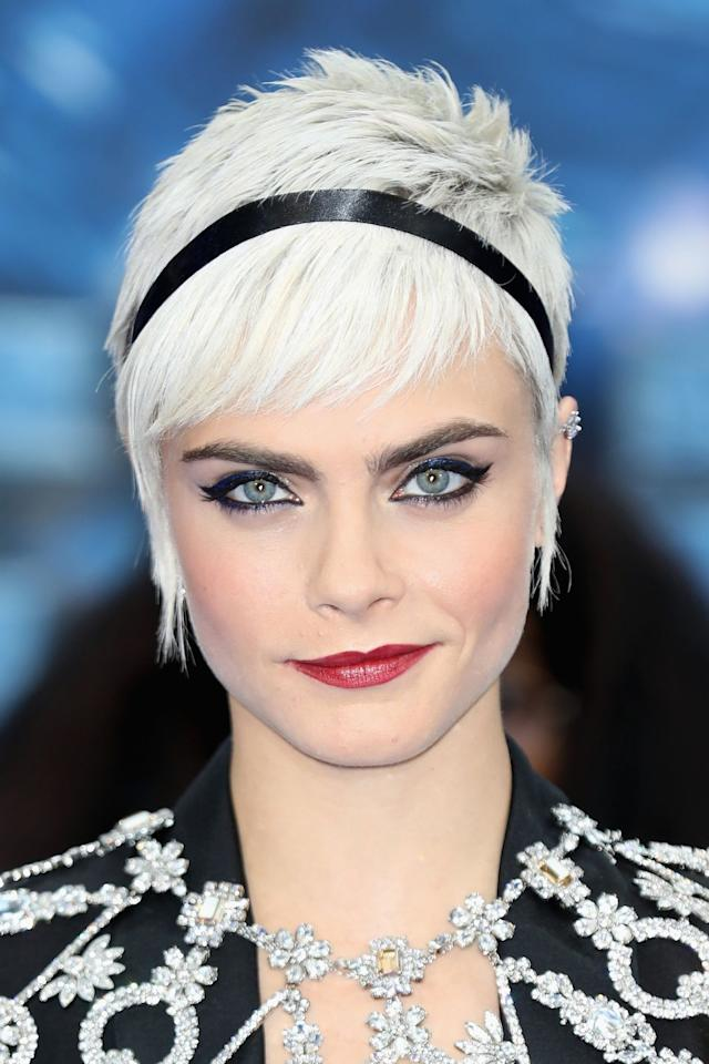 <p>Having shaved her head for a film role, Delevingne grew her hair out into an icy white blonde pixie cut.</p>