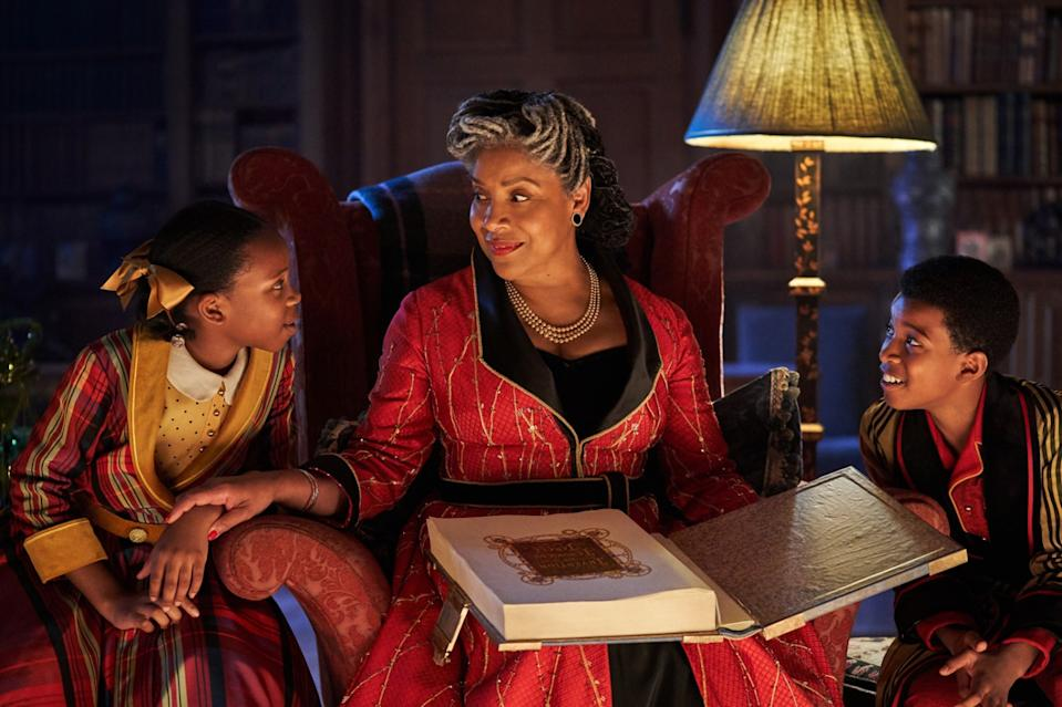 """Phylicia Rashad reads to Ria Calvin, left, and Kenyah Sandy in the movie """"Jingle Jangle: A Christmas Journey."""""""