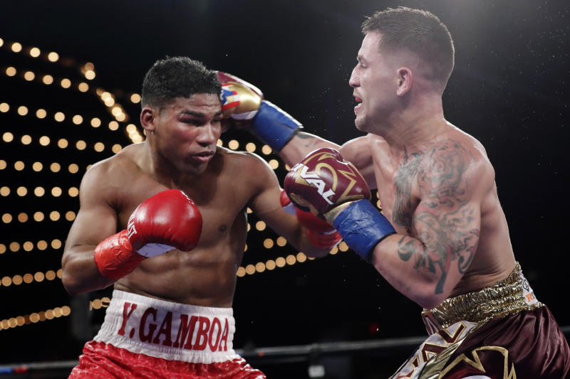 FILE - In this Nov. 25, 2017, file photo, Cuba's Yuriorkis Gamboa, left, fights Jason Sosa during the 10th round of a super featherweight boxing match in New York. Eager to take his career to a higher level, Gervonta Davis will move up to fight Cuba's Yuriorkis Gamboa for the WBA's secondary lightweight title.  AP Photo/Frank Franklin II, File)