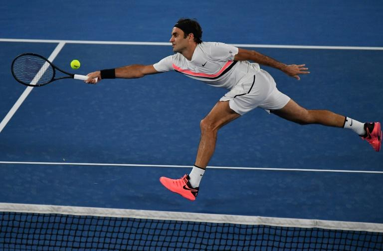 Switzerland's Roger Federer plays a forehand to Germany's Jan-Lennard Struff during their men's singles second round match at the Australian Open in Melbourne on January 18, 2018