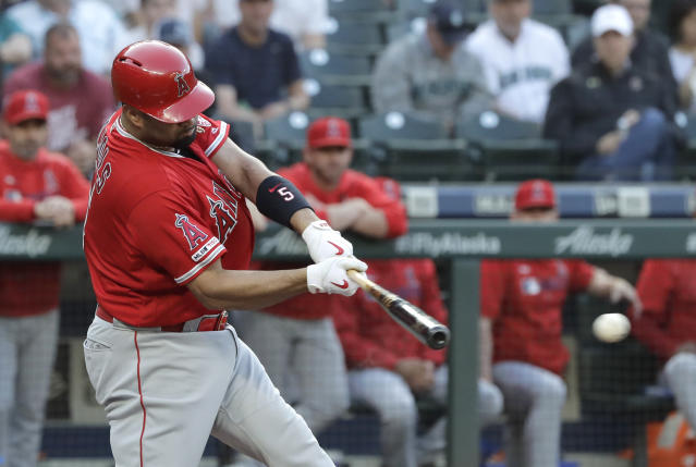 Los Angeles Angels' Albert Pujols hits an RBI single during the first inning of the team's baseball game against the Seattle Mariners, Thursday, May 30, 2019, in Seattle. (AP Photo/Ted S. Warren)