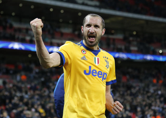 FILE - In this Wednesday, March 7, 2018 filer, Juventus' Giorgio Chiellini celebrates at the end of a the Champions League, round of 16, second-leg soccer match between Juventus and Tottenham Hotspur, at the Wembley Stadium in London. The Juventus captain -- who has a masters degree in business administration -- was the main go-between for millionaire teammates like Cristiano Ronaldo and management when the squad agreed to forgo 90 million euros ($100 million) in wages to help the club during the coronavirus crisis. (AP Photo/Frank Augstein, File)