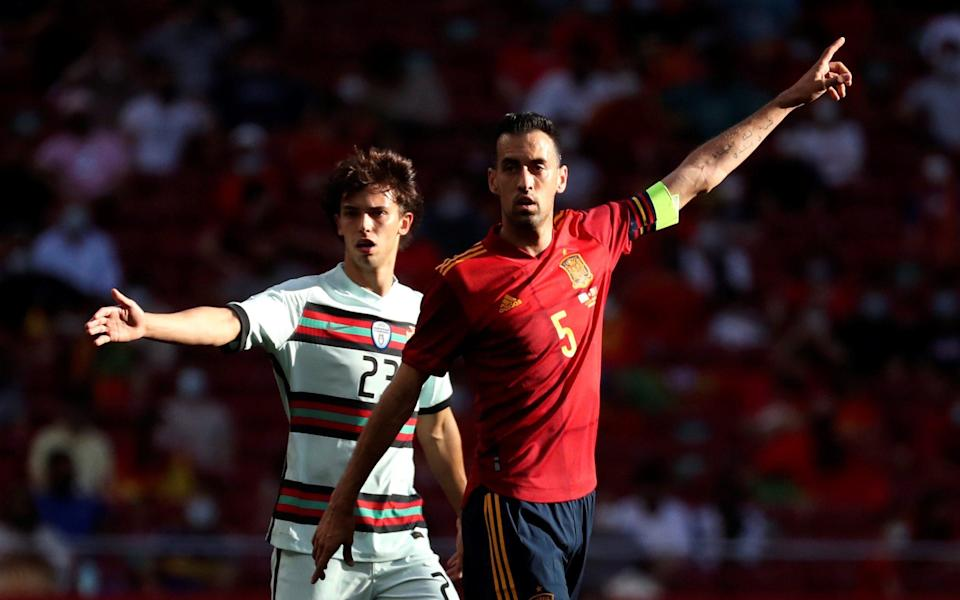 Spain's midfielder Sergio Busquets (R) and Portugal's striker Joao Felix (L) during the international friendly soccer match between Spain and Portugal at Wanda Metropolitano stadium in Madrid, Spain - SHUTTERSTOCK