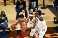 Texas Tech guard Terrence Shannon Jr., front left, looks over his shoulder at Oklahoma State guard Avery Anderson III (0) and forward Bernard Kouma (25) during an NCAA college basketball game Monday, Feb. 22, 2021, in Stillwater, Okla. (AP Photo/Brody Schmidt)