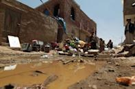 Yemenis gather near the rubble of houses near Sanaa Airport on March 31, 2015 (AFP Photo/Mohammed Huwais)