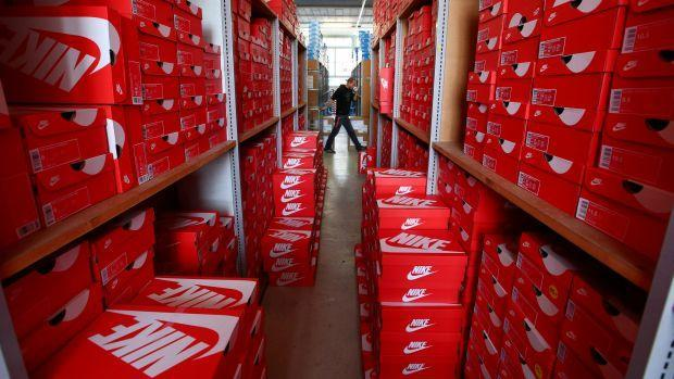 """Staff member Greg prepares a delivery in the Nike section in the warehouse of local footwear retailer """"Pomp It Up"""" in Bussigny near Lausanne, Switzerland"""