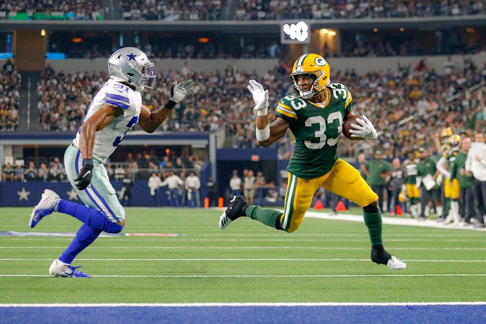 Green Bay Packers running back Aaron Jones was fined more than $10,000 for this wave. (Getty Images)