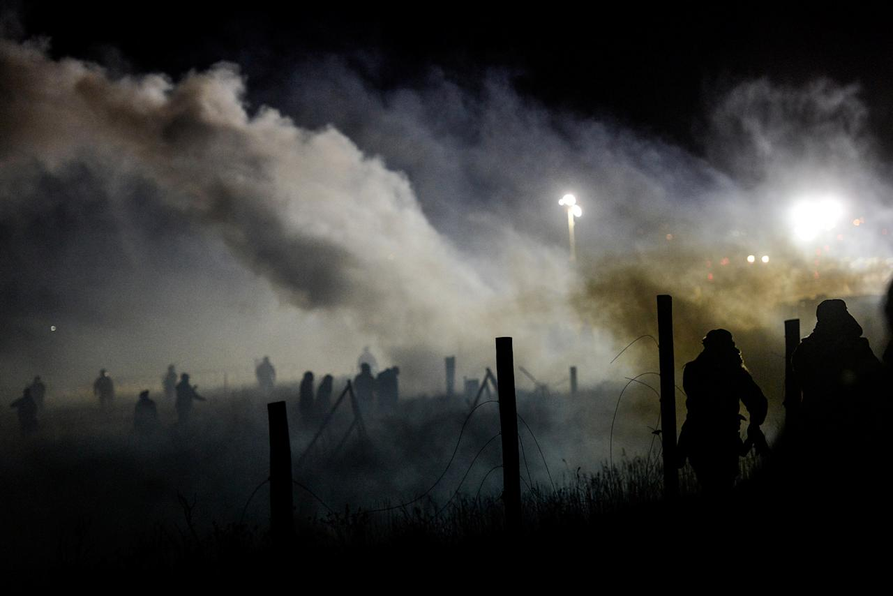 <p>Police tear gas protesters during a protest against plans to pass the Dakota Access pipeline near the Standing Rock Indian Reservation, near Cannon Ball, N.D., on Nov. 20, 2016. (Stephanie Keith/Reuters) </p>