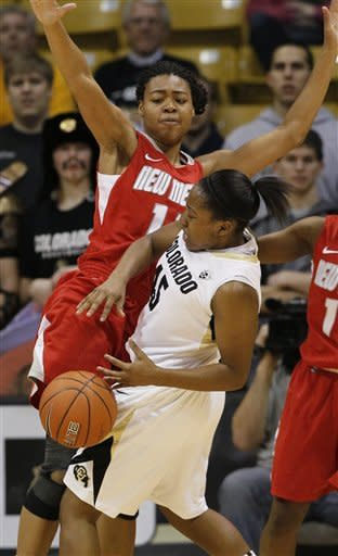 Colorado guard Kyleesha Weston, front, loses control of the ball as New Mexico center Khadijah Shumpert covers in the first half of an NCAA college basketball game in Boulder, Colo., on Saturday, Dec. 29, 2012. (AP Photo/David Zalubowski)