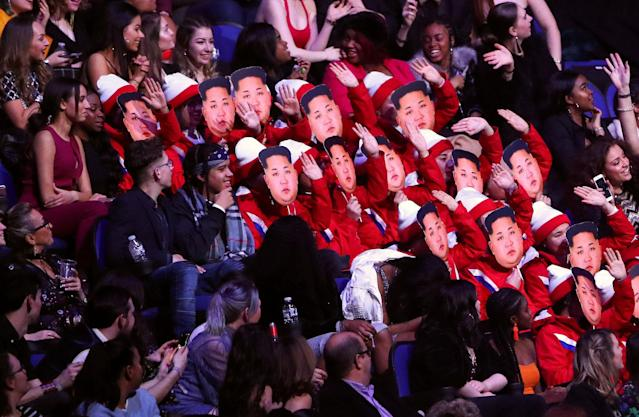 Spectators wear Kim Jong-un masks as they impersonate the North Korean cheerleaders at the Winter Olympic Games at the Brit Awards at the O2 Arena in London, Britain, February 21, 2018. REUTERS/Hannah McKay TPX IMAGES OF THE DAY