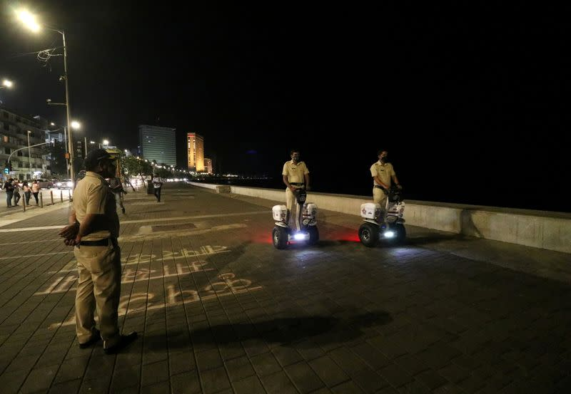 FILE PHOTO: Police officers patrol on Segways along the promenade at Marine Drive during a curfew to limit the spread of the coronavirus disease (COVID-19), in Mumbai