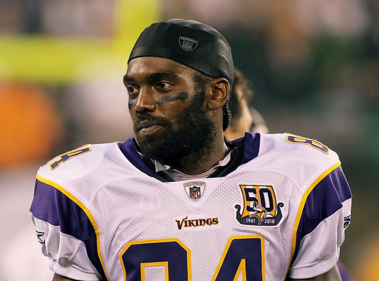 EAST RUTHERFORD, NJ - FILE:  Randy Moss #84 of the Minnesota Vikings looks on against the New York Jets at New Meadowlands Stadium on October 11, 2010 in East Rutherford, New Jersey.  It was announced by his agent that WR Randy Moss has decided to retire from football August 1, 2011.  (Photo by Jim McIsaac/Getty Images)