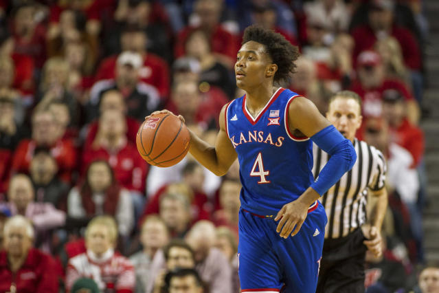 Can Devonte Graham-led Kansas extend its Big 12 title streak? It won't be easy. (AP Photo/John Peterson)
