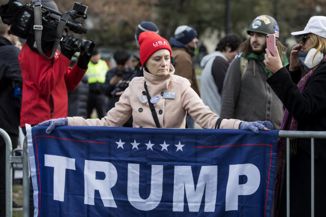 <p>A participant of an Alt-Right organized free speech event drapes a Trump campaign flag at the Boston Common on Nov. 18, 2017, in Boston, Mass. (Photo: Scott Eisen/Getty Images) </p>