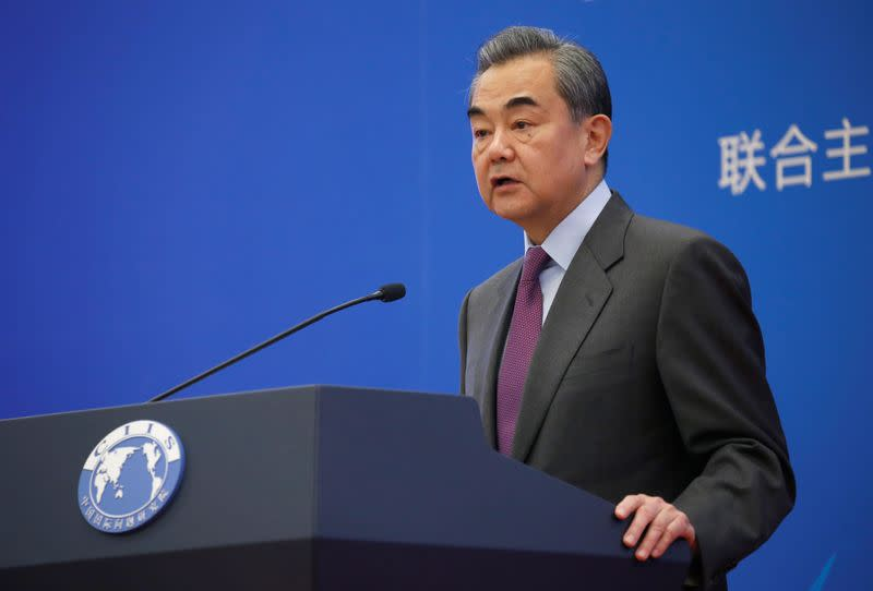 Chinese Foreign Minister Wang Yi delivers a speech at an annual symposium on international situation and China's diplomacy in Beijing