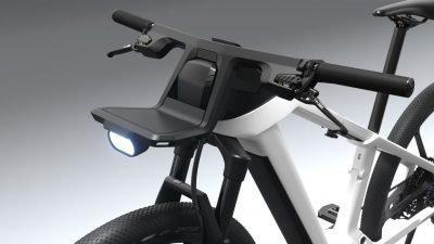 A small permanenet LED riding light is attached under the eBike's front luggage rack.