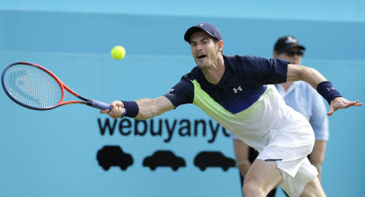 Andy Murray of Britain plays a return to Nick Kyrgios of Australia during their singles tennis match at the Queen's Club tennis tournament in London, Tuesday, June 19, 2018. (AP Photo/Kirsty Wigglesworth)