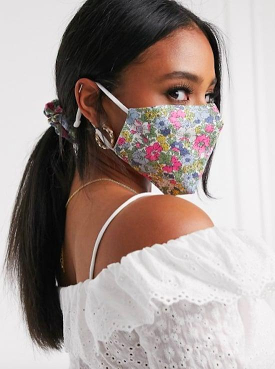 <p><span>ASOS DESIGN Pink Floral Face Covering With Pouch &amp; Scrunchie</span> ($19)</p>