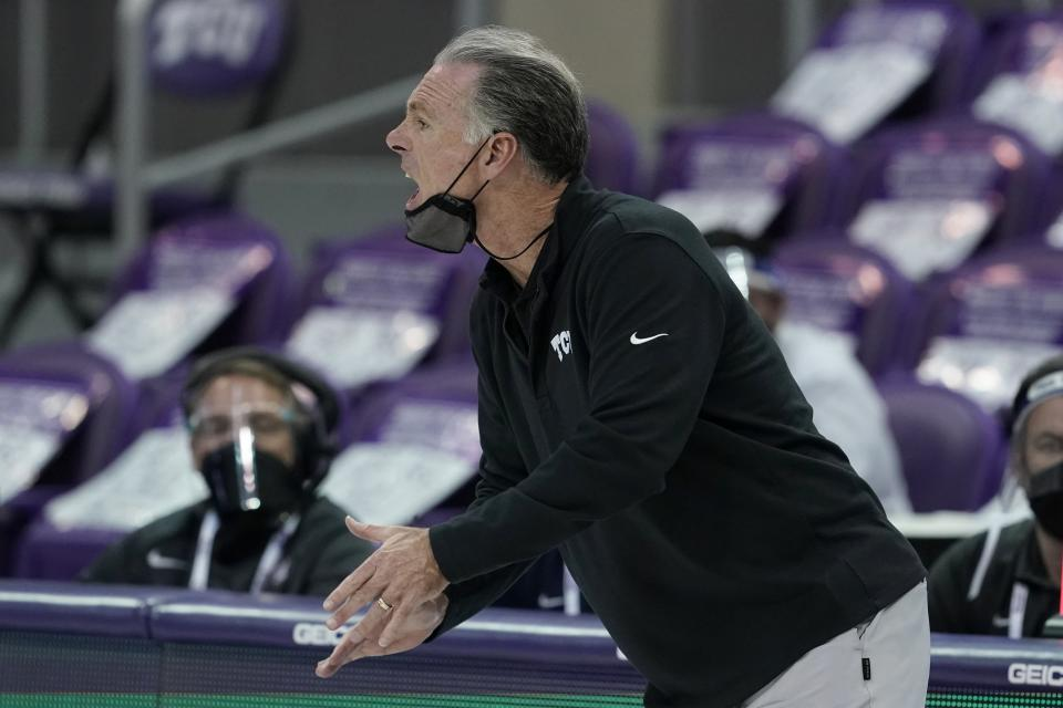 TCU head coach Jamie Dixon instructs his team in the second half of an NCAA college basketball game against West Virginia in Fort Worth, Texas, Tuesday, Feb. 23, 2021. (AP Photo/Tony Gutierrez)