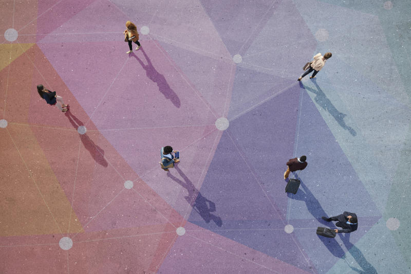 Group of young adults, photographed from above, on various painted tarmac surface, at sunrise. Photo: Getty
