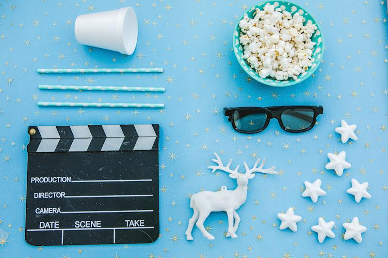 movie tickets, clapperboard, pop corn and 3d glasses in a red frame background..Flat lay .Christmas concept