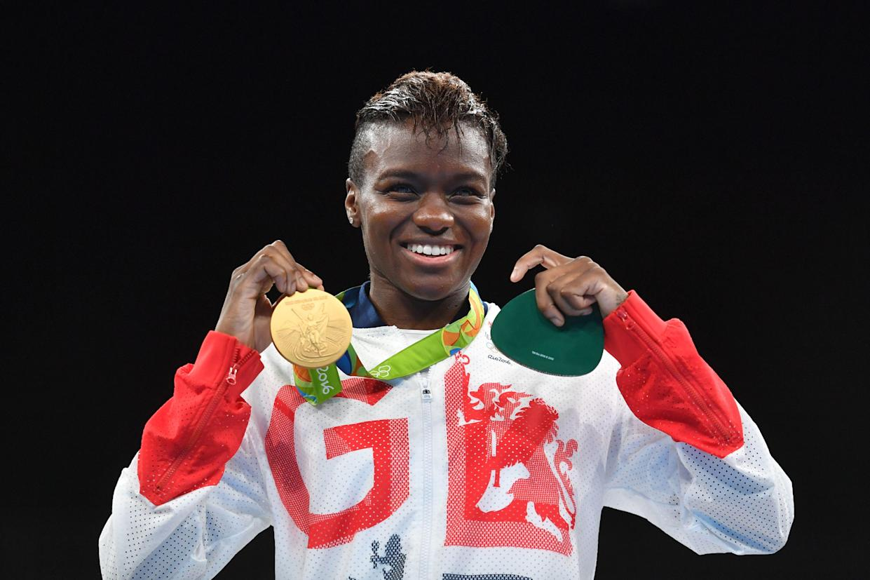 Great Britain's Nicola Adams poses on the podium with a gold medal during the Rio 2016 Olympic Games at the Riocentro - Pavilion 6 in Rio de Janeiro on August 20, 2016.   / AFP PHOTO / Yuri CORTEZ        (Photo credit should read YURI CORTEZ/AFP via Getty Images)